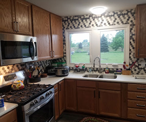 Stainless Stove And Microwave In New Kitchen