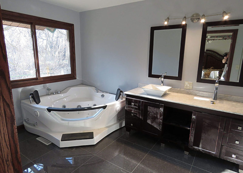 Vanity With Double Sink and Jacuzzi Tub