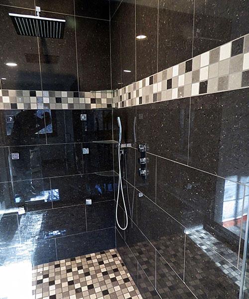 Dark Tile Seen Through Glass Shower