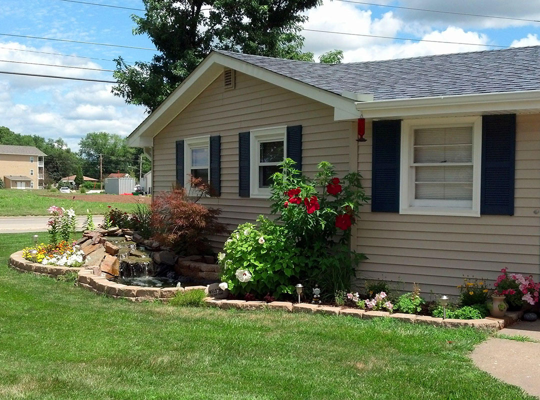 New Siding And Roof With Landscaping