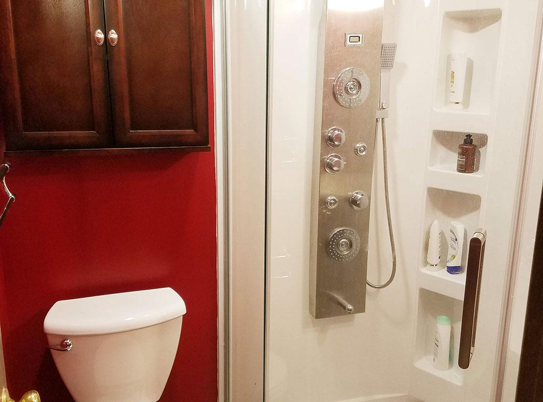 Shower Inside Red Bathroom