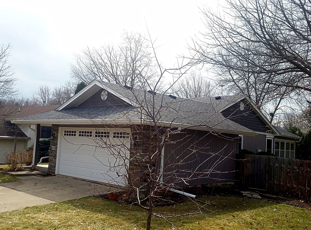 Front View Of Home With New Siding And New Roof